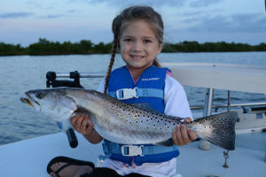 catching big speckled trout in mosquito lagoon