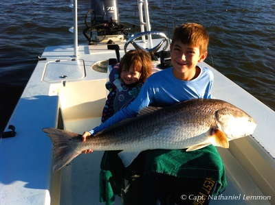Trophy Bull Redfish caught on Beavertail skiff